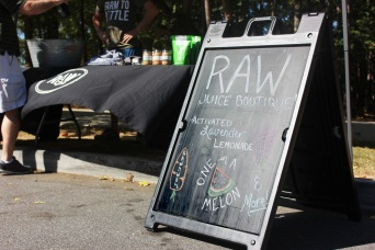 A man orders a lavender lemonade from the raw juice bar at the Downtown Woodstock Farmer's Market on Oct. 8, 2016. The farmer's market hosts different vendors in Woodstock, Ga.